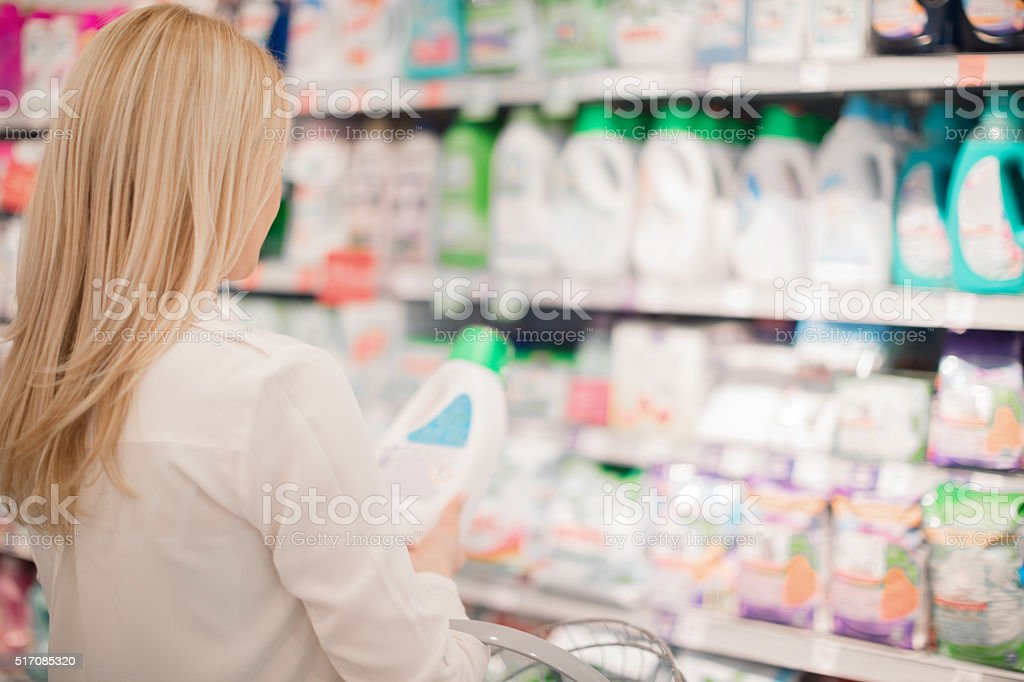 Woman choosing fabric softener stock photo