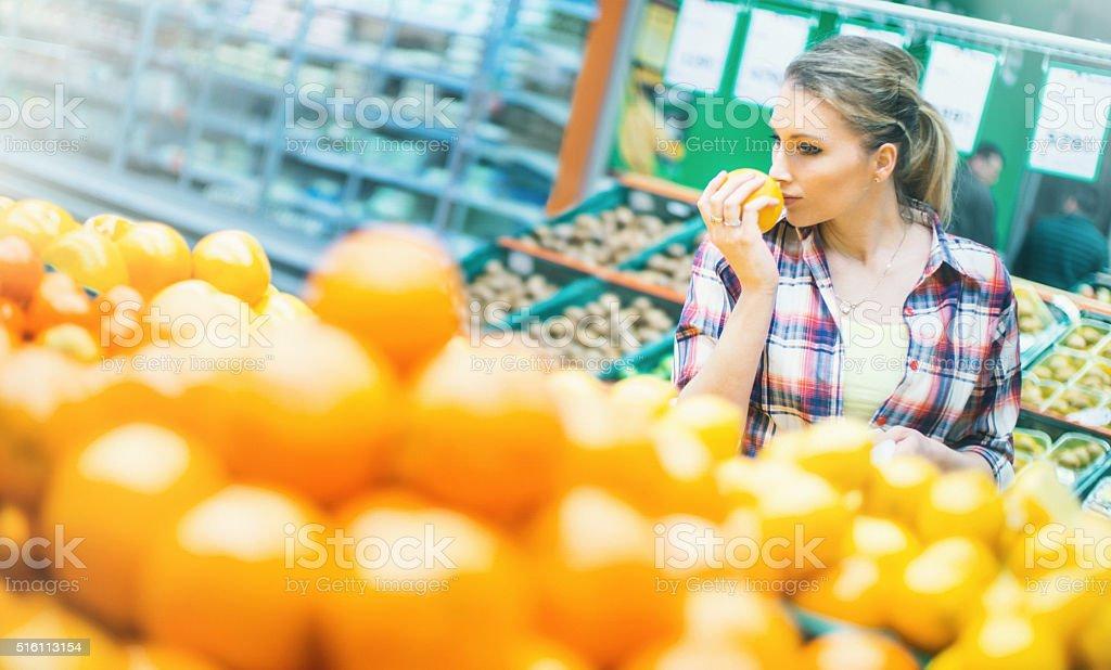 Woman choosing fruit in supermarket. stock photo
