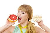 Woman choosing fruit or cake make dietary choice