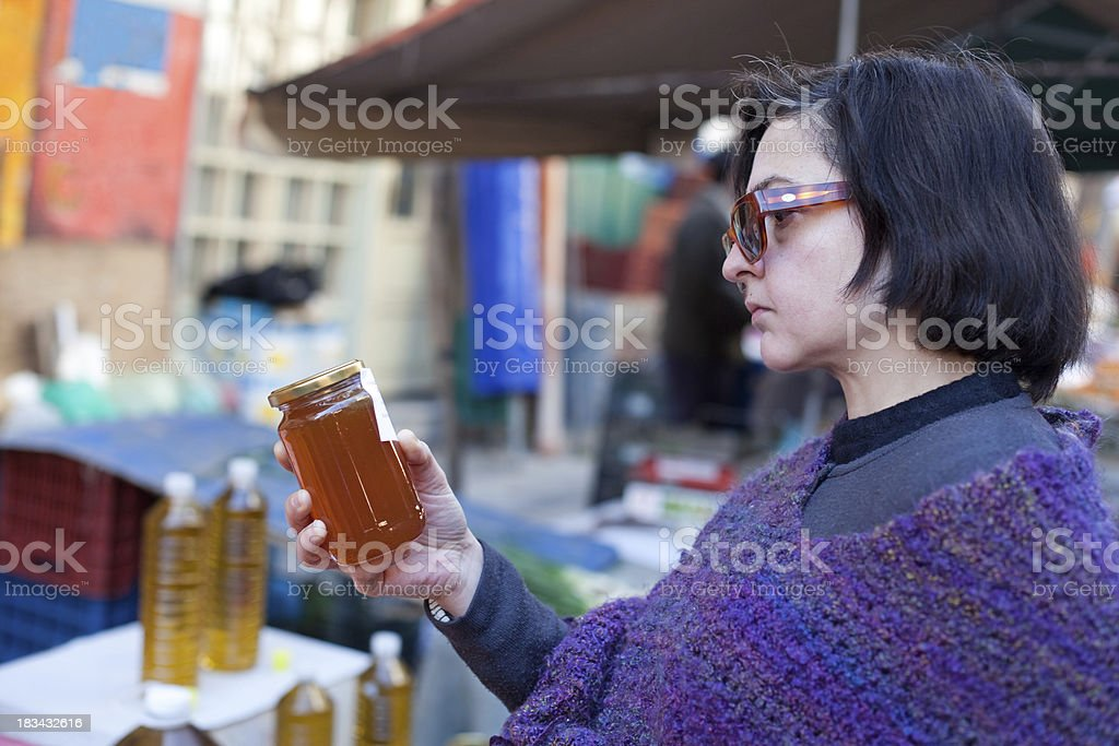 Woman choosing honey stock photo