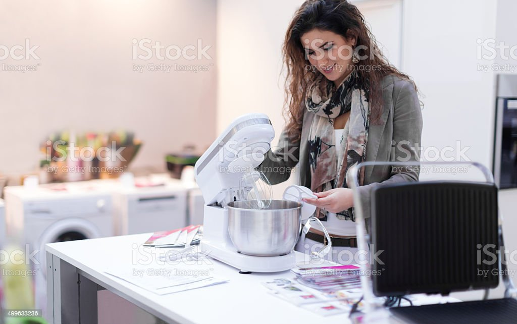 Woman choosing new mixer stock photo
