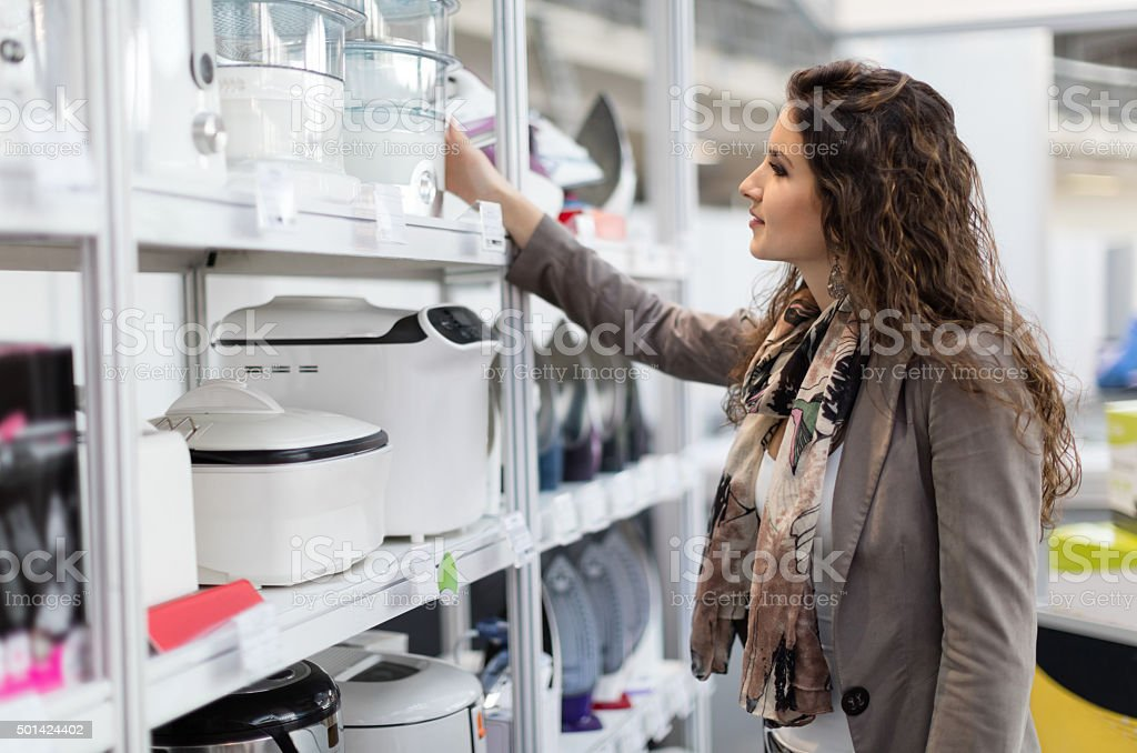 Woman choosing new steamer stock photo
