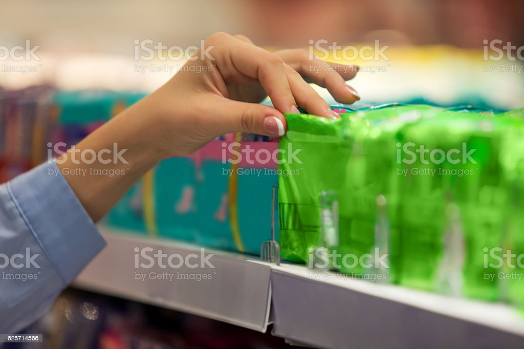 Woman choosing pad stock photo