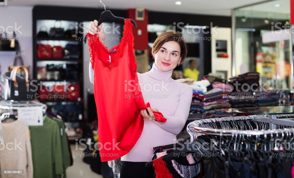 Woman choosing pretty dress stock photo