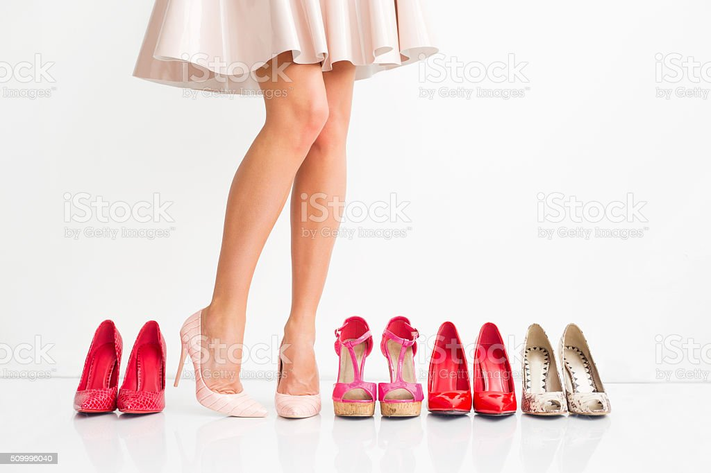 Woman choosing right shoes stock photo