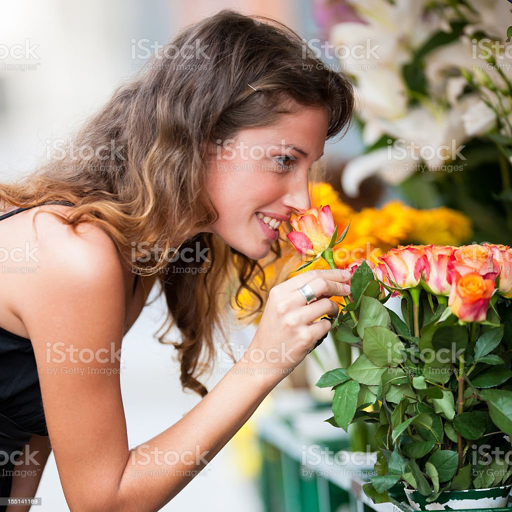 Woman choosing rose at flower market stock photo