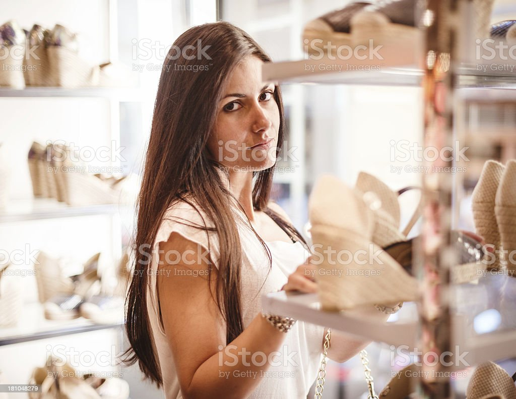 woman choosing shoes at the store royalty-free stock photo