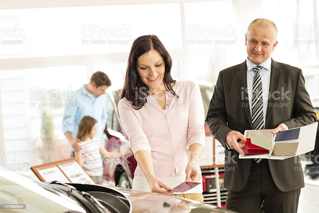 Woman choosing the color of family car royalty-free stock photo