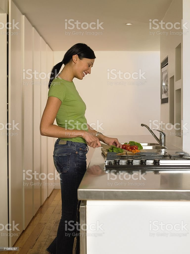 Woman chopping vegetables royalty-free stock photo