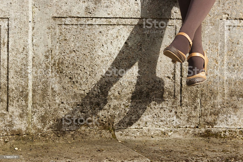 Woman classic fashion shoes in shadow stock photo