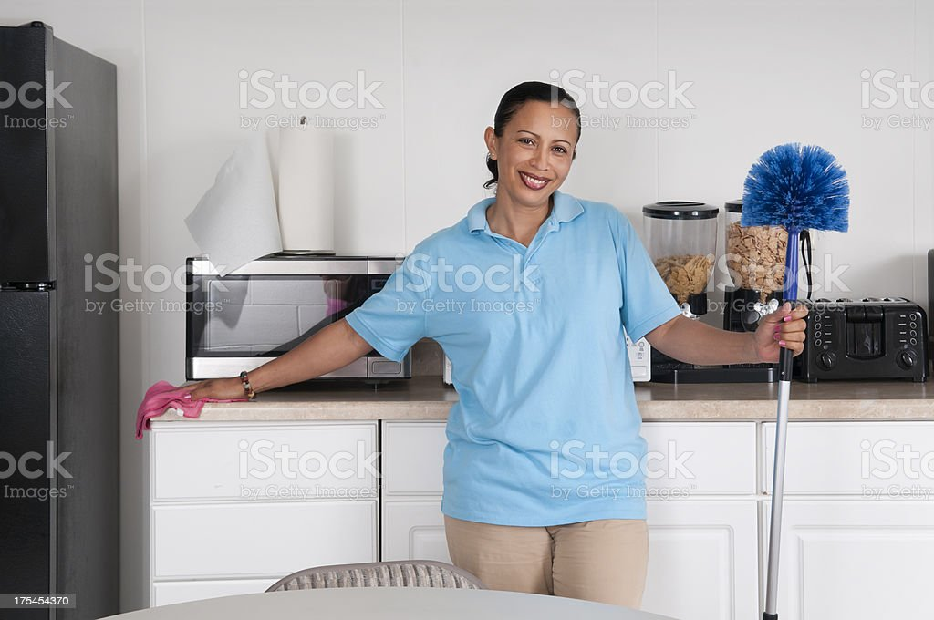 Woman Cleaning a Corporate Break Room royalty-free stock photo