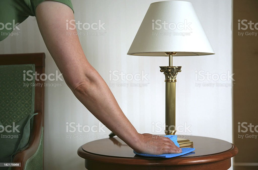 Woman cleaning a table royalty-free stock photo