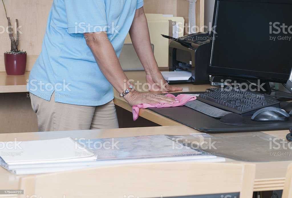 Woman Cleaning an Office stock photo