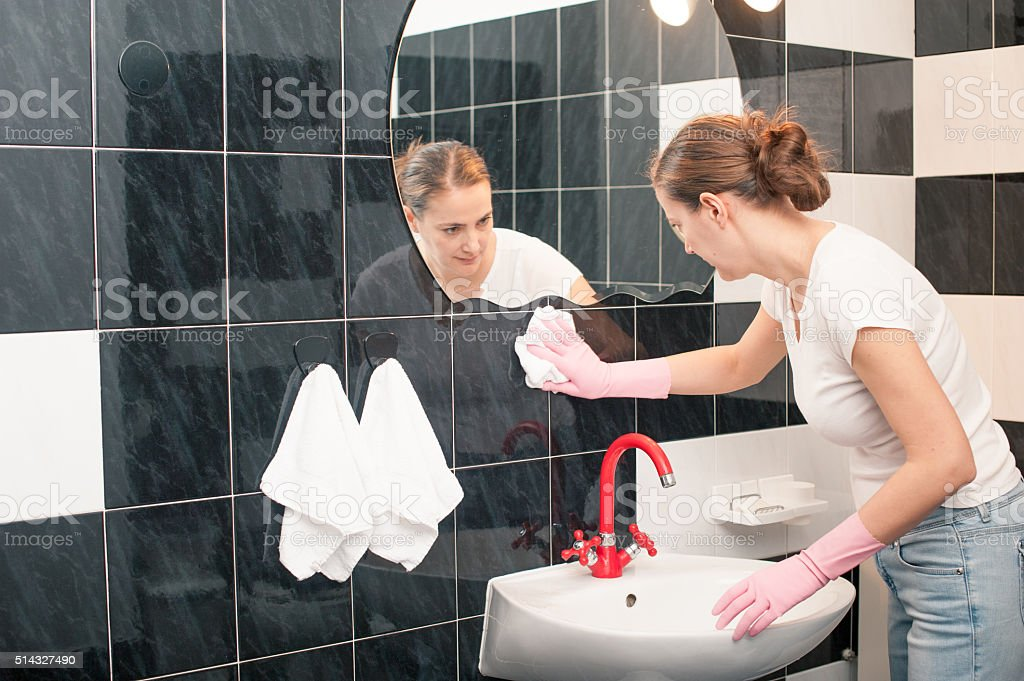 Woman Cleaning Bathroom Tiles stock photo