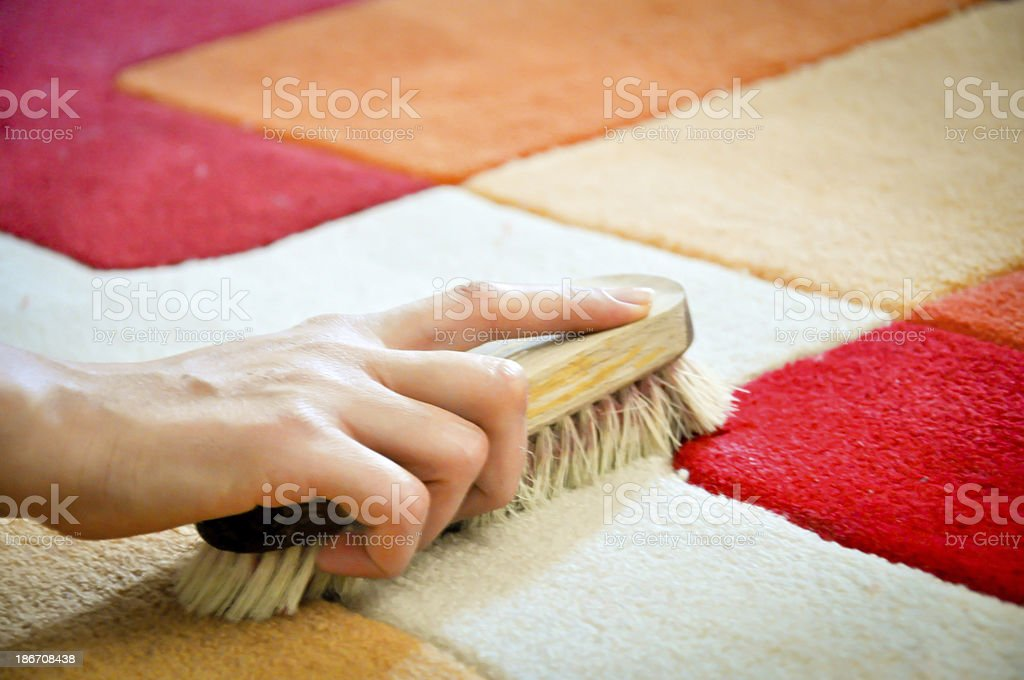 woman cleaning carpet from stain stock photo
