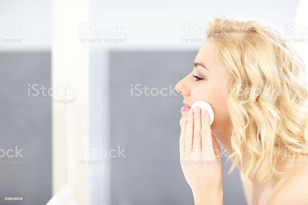 Woman cleaning face stock photo