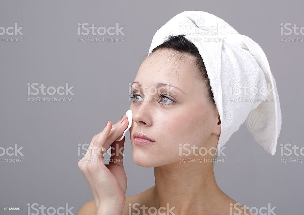 woman cleaning face royalty-free stock photo