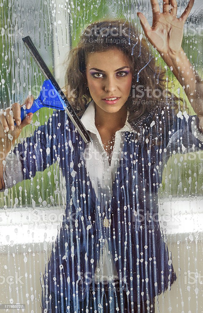 Woman cleaning her windows stock photo