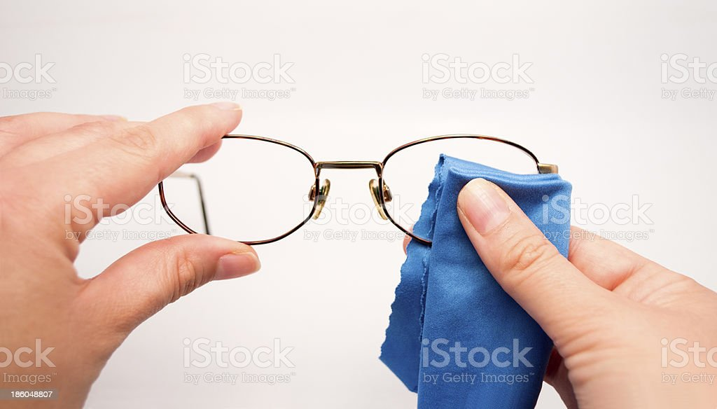 woman cleaning his glasses stock photo