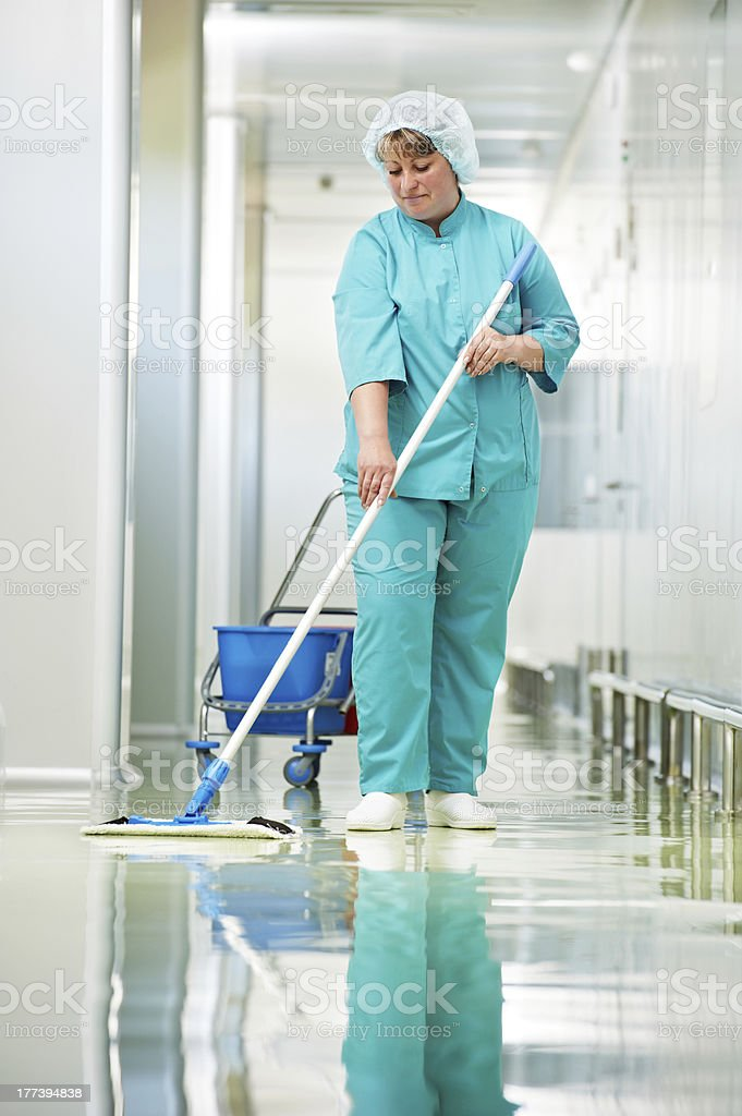 Woman cleaning hospital hall royalty-free stock photo