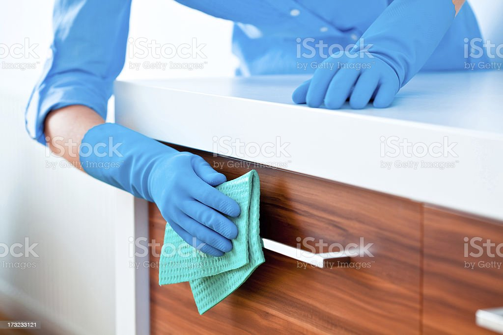 Woman Cleaning Kitchen Cabinets royalty-free stock photo