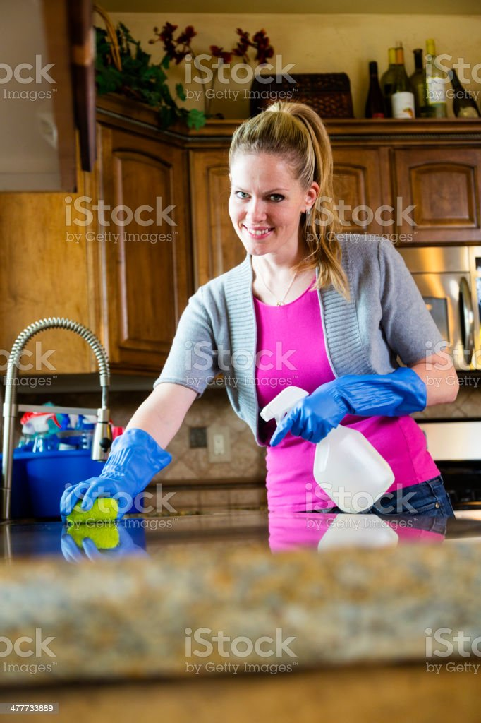 Woman Cleaning Kitchen royalty-free stock photo