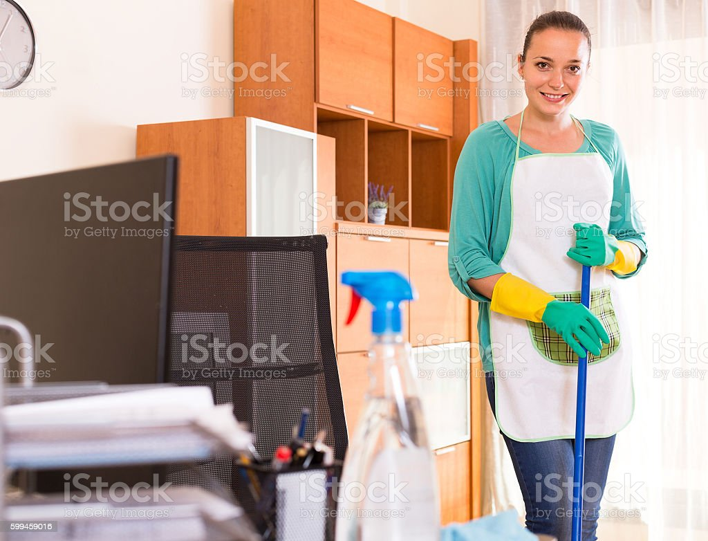 Woman cleaning office room stock photo