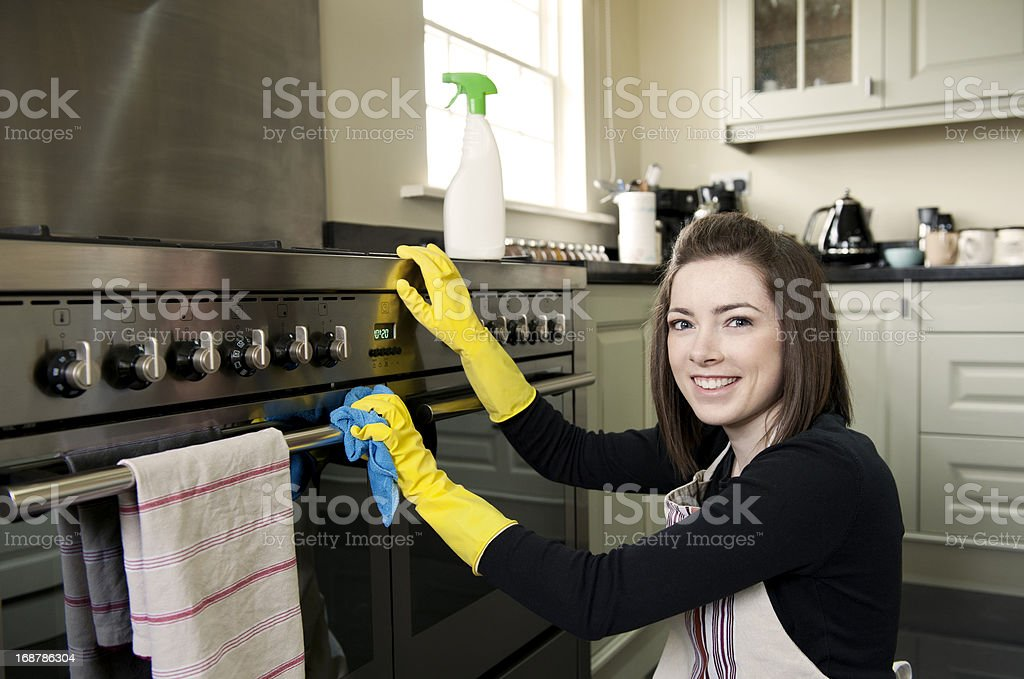 Woman cleaning oven royalty-free stock photo