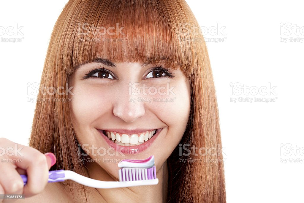 Woman cleaning teeth royalty-free stock photo