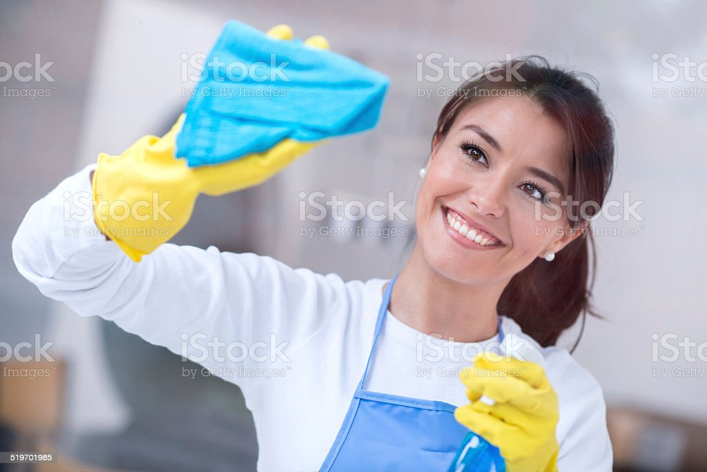 Woman cleaning the house stock photo