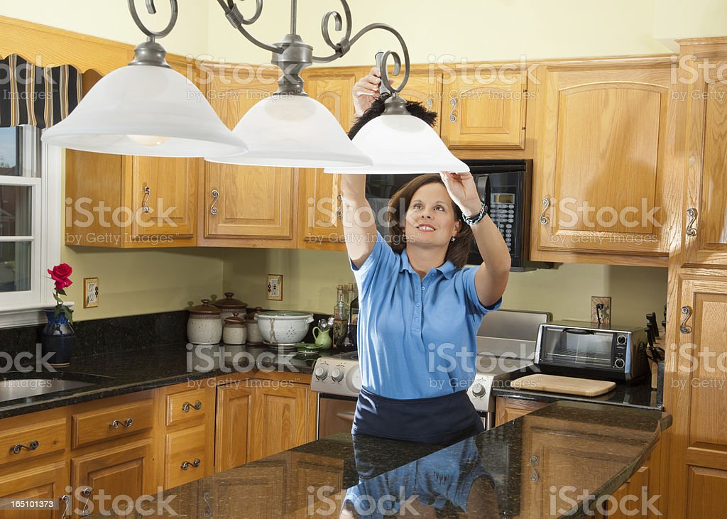 Woman Cleaning The Kitchen stock photo