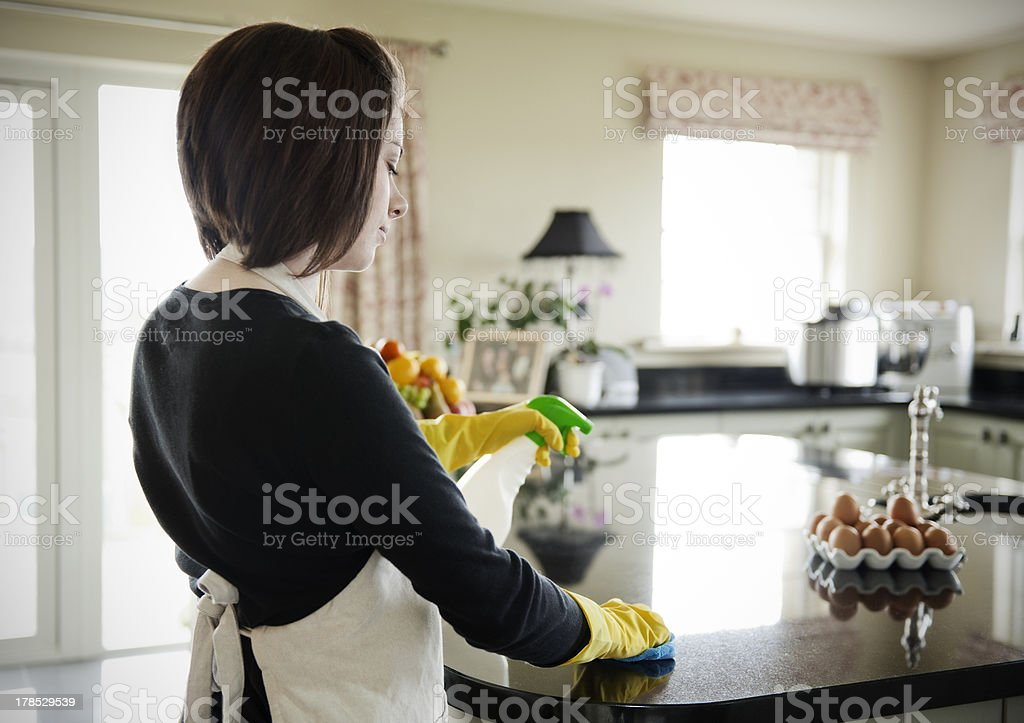 Woman cleaning the work surface royalty-free stock photo