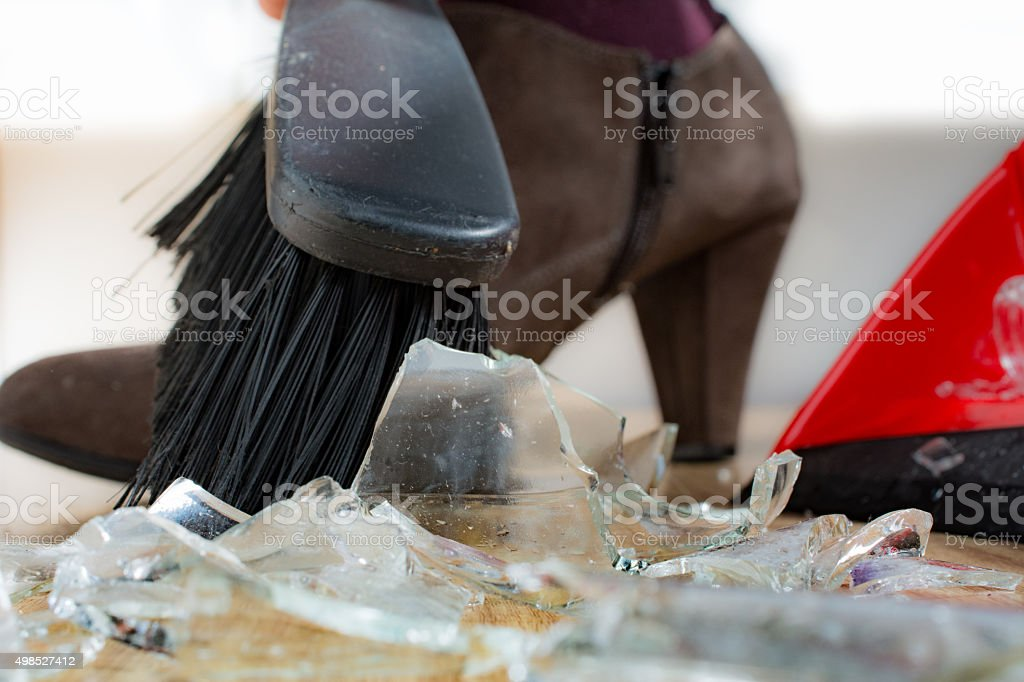 woman cleaning up glass stock photo