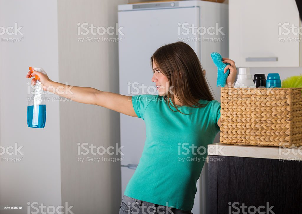 Woman cleaning up her house stock photo