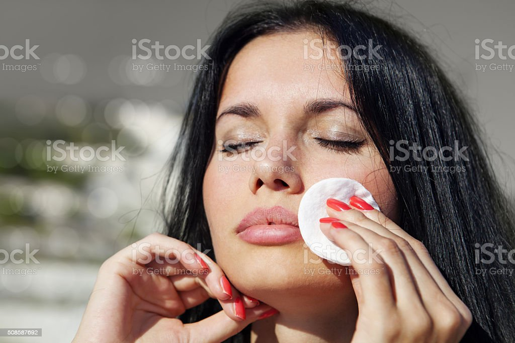 woman cleans her face stock photo