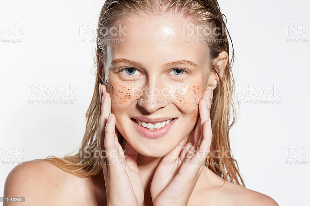 Woman cleans the skin coffee scrub stock photo