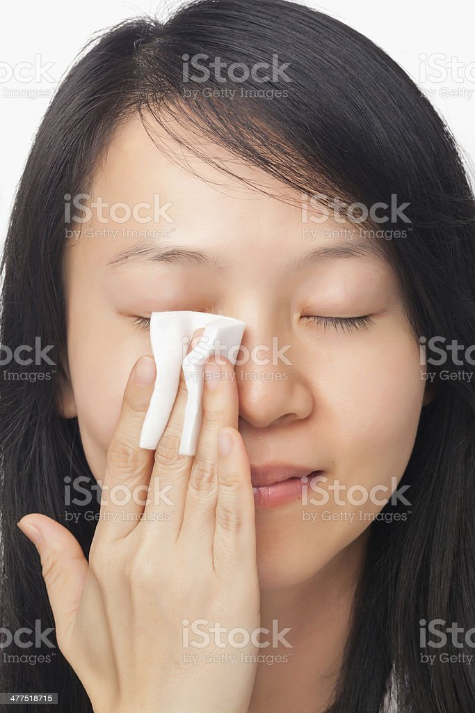 Woman cleansing face stock photo
