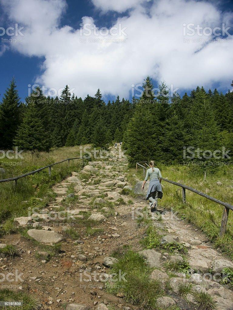 Woman climb a mountain. stock photo
