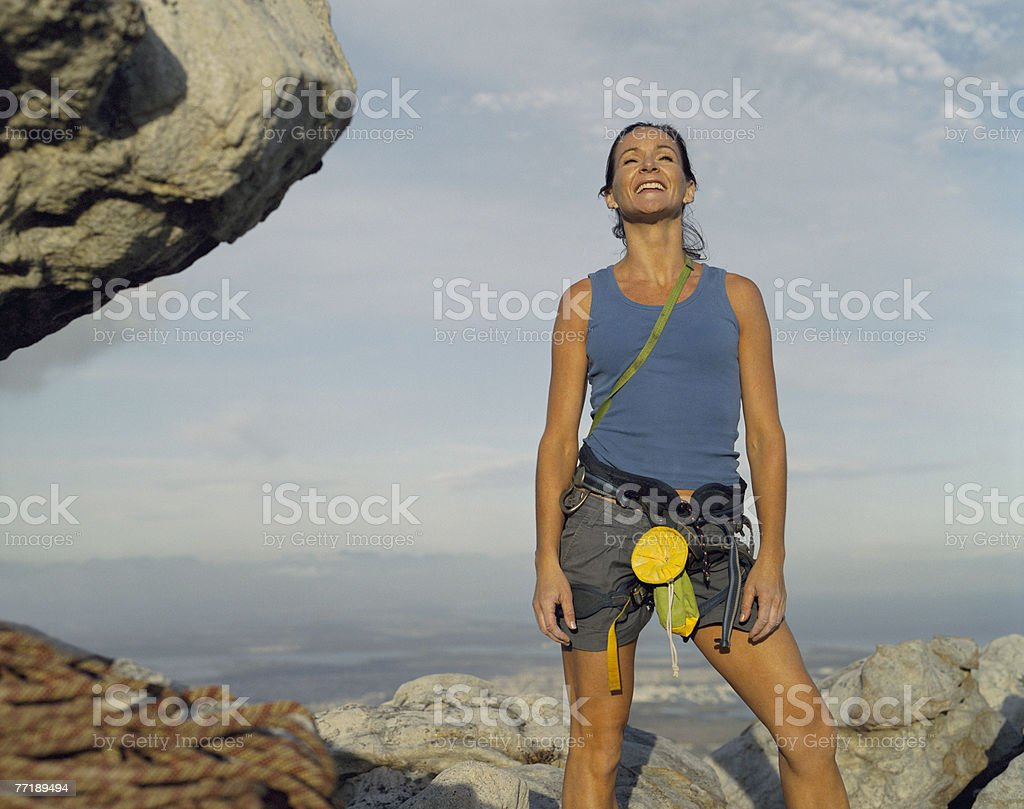 A woman climber at the top of a mountain royalty-free stock photo