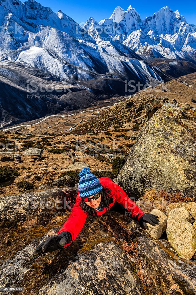 Woman climbing in Mount Everest National Park, Nepal stock photo