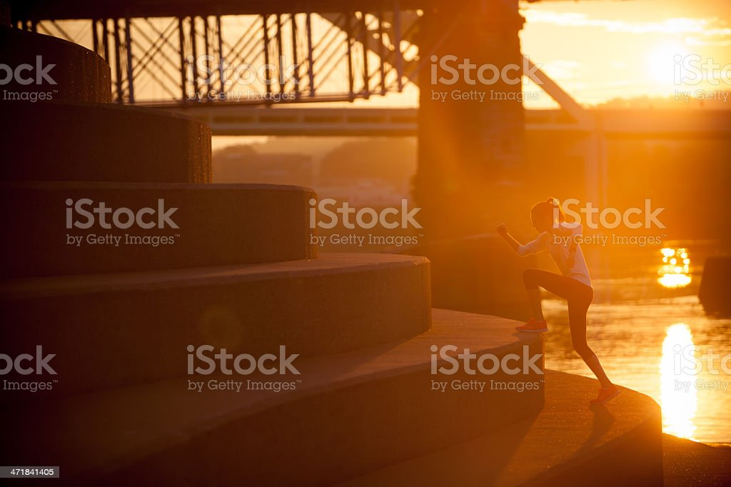 Woman climbing stairs along Ohio River in Cincinnati stock photo