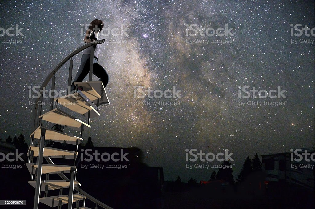 woman climbing to the stars stock photo