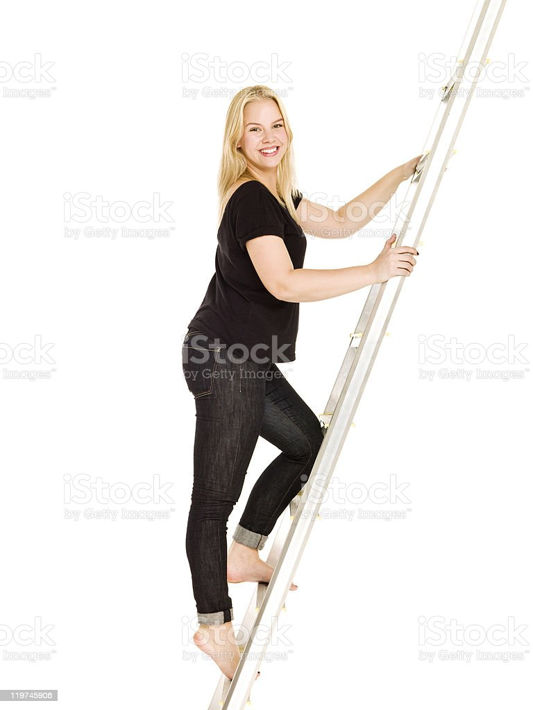 Woman climbing up the ladder royalty-free stock photo