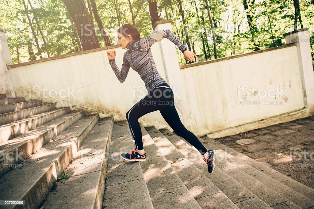 Woman Climbing Up The Stairs stock photo