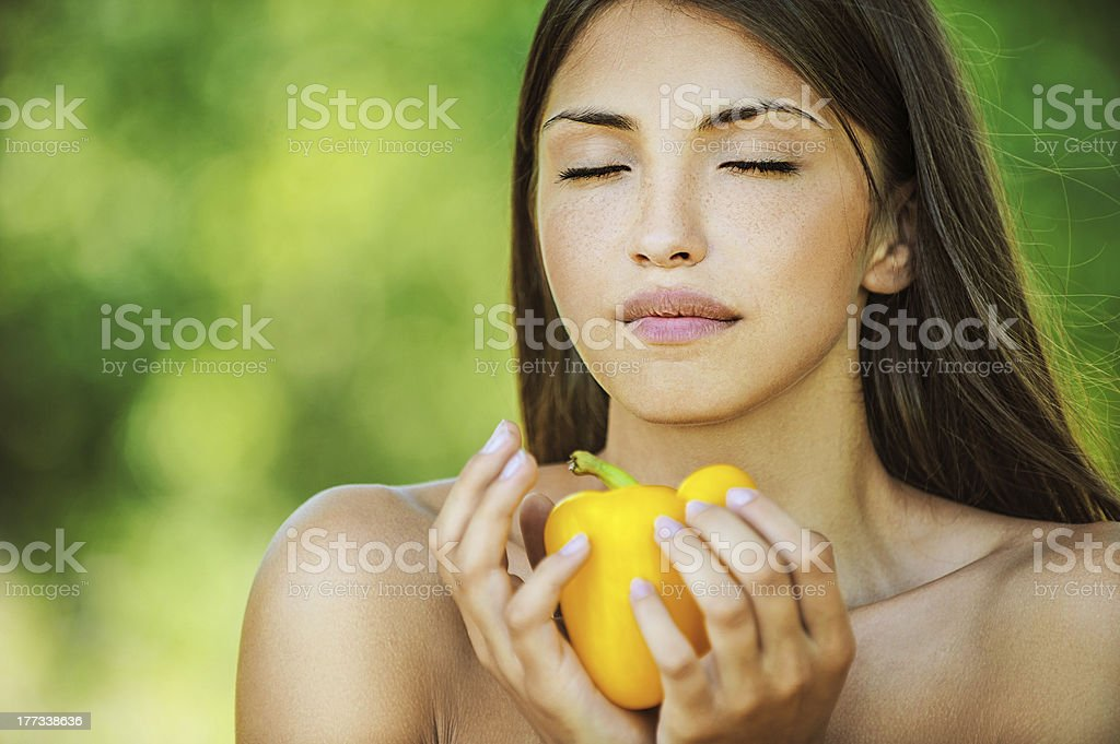 woman closed her eyes and holding yellow pepper stock photo