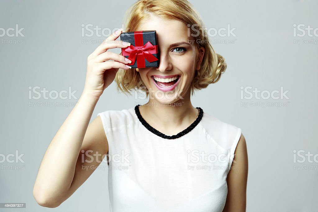 woman closing eye with jewelery gift box stock photo