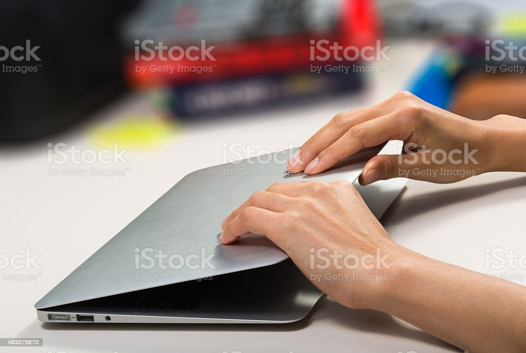 woman closing/opening her laptop stock photo