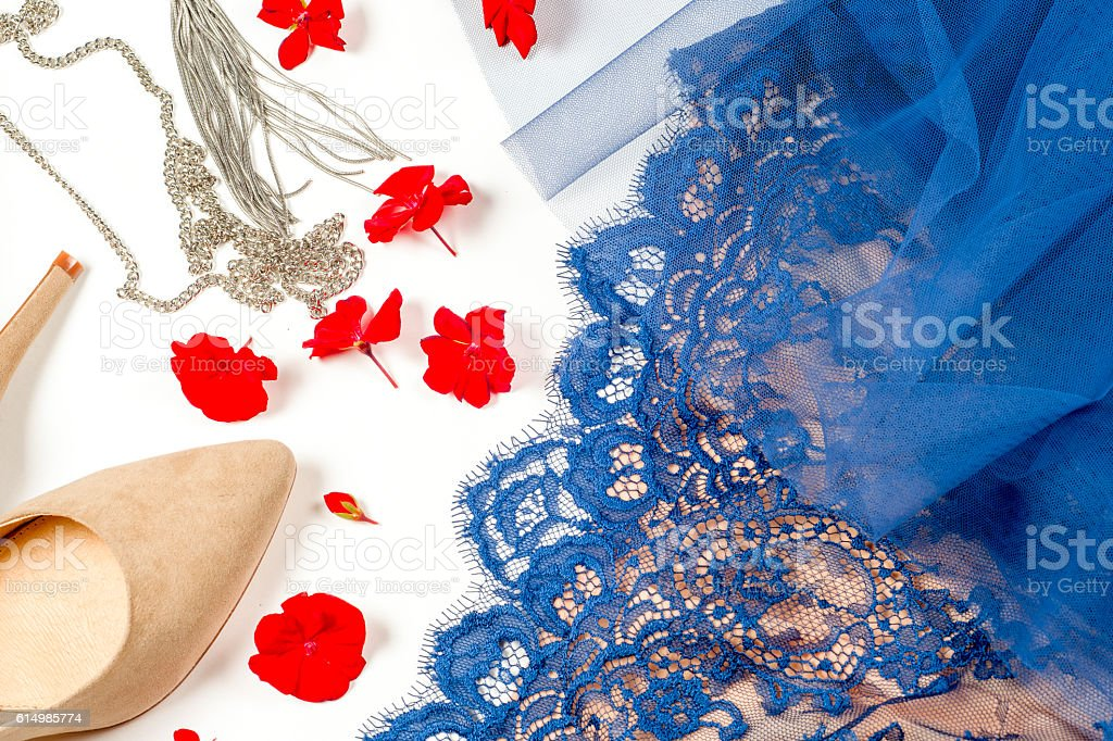 Woman clothes and accessories. Soft blue colors female apparel. stock photo