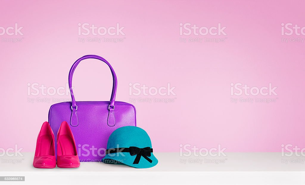 Woman colorful accessories isolated on pink. stock photo