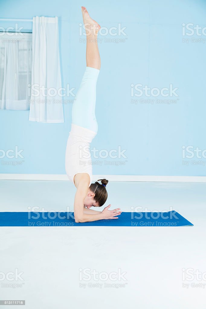Woman Combining Yoga And Gymnastics stock photo